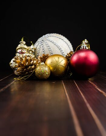 adorning: christmas ornament on wooden board