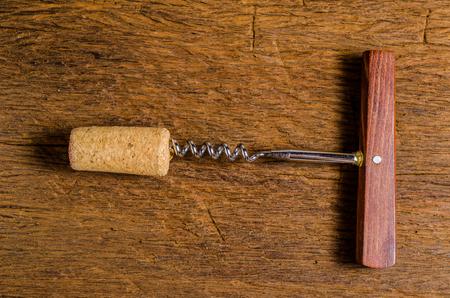 uncork: corkscrew for open winecork on wooden background Stock Photo
