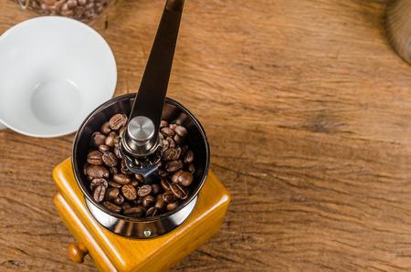 grinder: coffee grinder and coffee cup