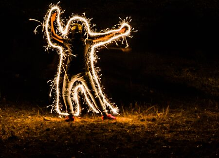 light painting: light painting around the man from firework Stock Photo