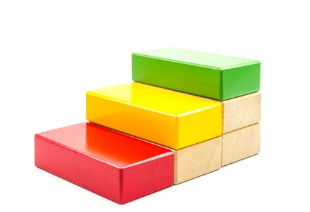 Concept of growth in business,stack of wooden block isolated on white background Stock Photo