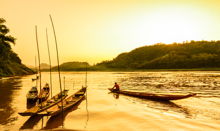 khong river: Sunset scene of wooden boat at river bank ,Khong River,Laos