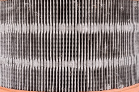 spare part: Close up of used air filter auto spare part isolated on white background