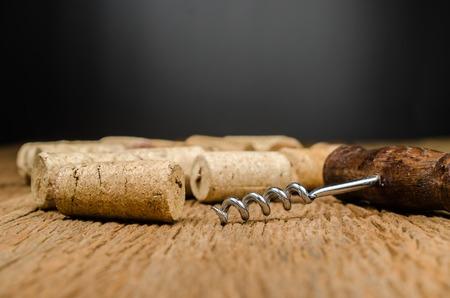 uncork: corkscrew for open wine cork bottle on wooden background Stock Photo