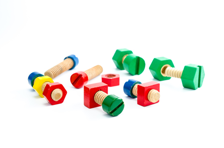 bolts and nuts: Colorful wooden nuts and bolts toy isolated on white background Stock Photo