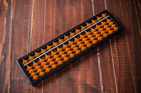 retro abacus isolated on wooden background