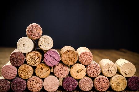 uncork: wine cork on wooden background with black background