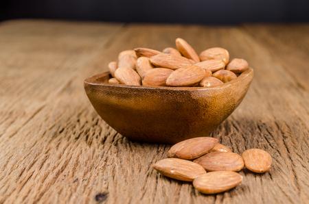 protien: almond in wooden bowl on wooden board