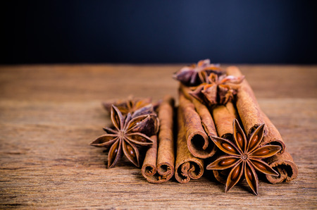 Star anise and cinnamon stick on wooden board background,Chinese star aniseed