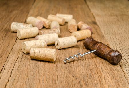 corkscrew for open wine cork bottle on wooden background Stock Photo