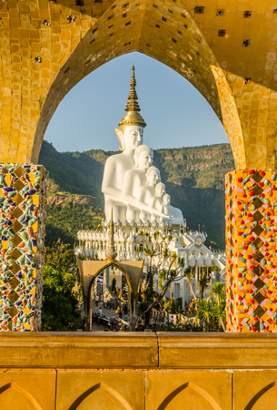 public domain: White big buddha statue against mountain at wat phasornkeaw ,Thailand Stock Photo