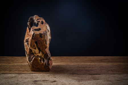 firewood on wooden board with black background