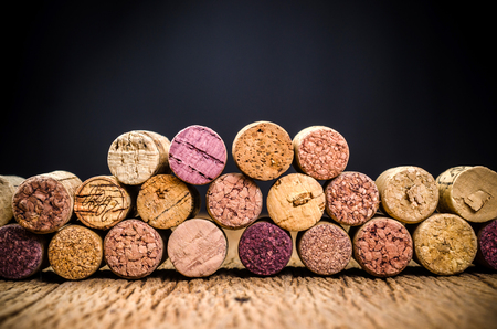 wine cork on wooden background with black background