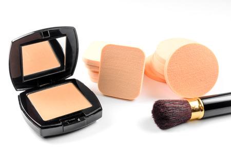 Face powder sponge with powder and brush on white background Stock fotó