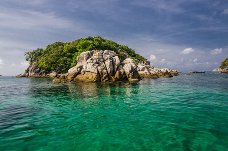 small island with clear water at the south of Thailand