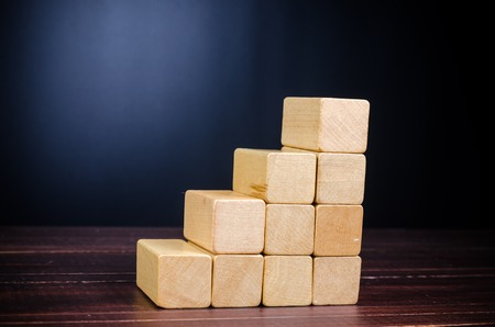 Concept of growth in business,stack of wooden block on wooden board background Stock Photo