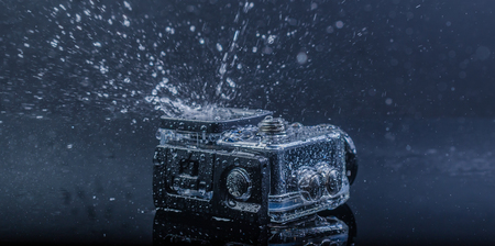 Bangkok Thailand-January 11,2018:  action camera in waterproof case with water splash