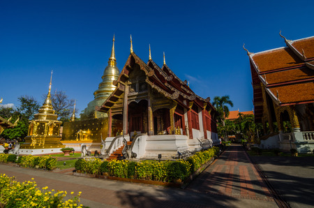 Old Church and golden pagoda at phra singh temple at the northern of Thailand ,Chiangmai ,Thailand