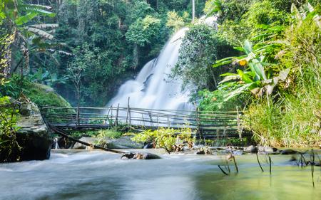 beautiful waterfall and bamboo bridge at the northern of Thailand, Pha Dok Xu fall ,Mae Klang Luang village, Doi Inthanon National park, Chiangmai , Thailand