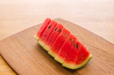 Fresh sliced watermelon on wooden board background Stockfoto