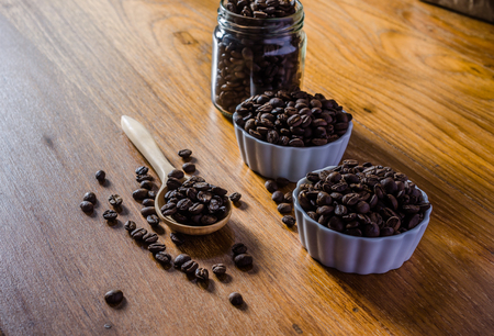 roasted coffee beans on wooden board background