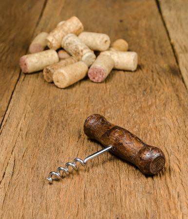 corkscrew for open wine cork bottle on wooden background Stockfoto