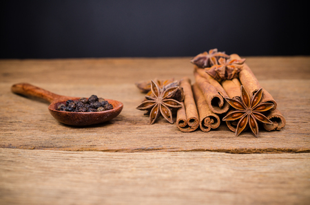 Star anise and cinnamon stick with black pepper on wooden board background,Chinese star aniseed  Stockfoto