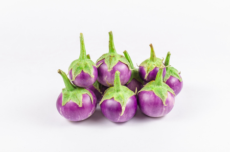 Group of fresh purple eggplant in sack bag isolated on white background