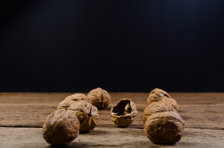 Heap of walnuts on wooden table