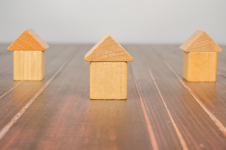 House wooden toy blocks on wooden board background, concept image