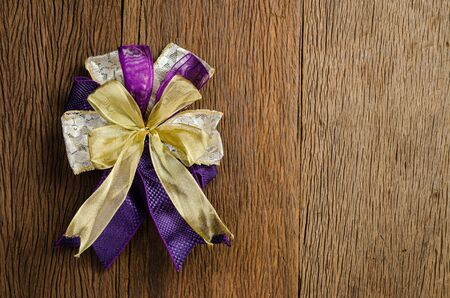 satin ribbon gift bow on wooden board background,satin bow