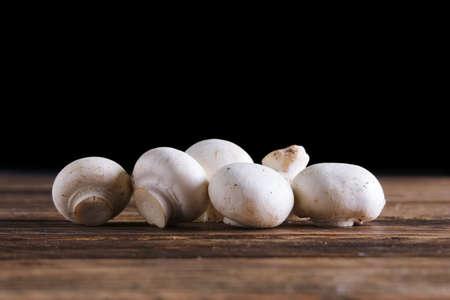 Fresh champignon on wooden background