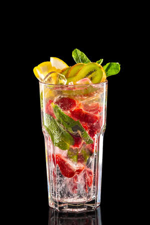 Glass of raspberry, kiwi and lemon ice lemonade isolated on black background 스톡 콘텐츠