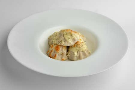 Deep plate with fried pelmeni with cheese 版權商用圖片
