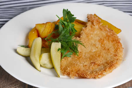 Chicken entrecote with potato and salty cucumber Stock Photo