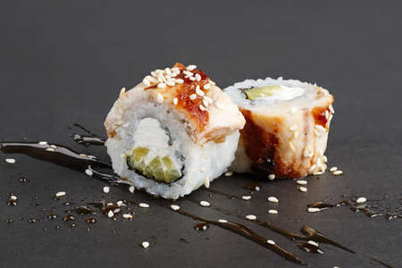 Eel rolls with cucumber, sesame, cheese and smoked sauce.