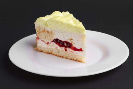 Cherry cake with whipped cream Stock Photo
