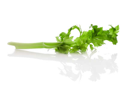 Celery, halm and leaves with reflection on white background