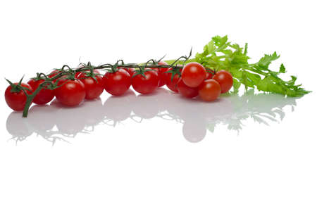 Celery and tomato with reflection on white background