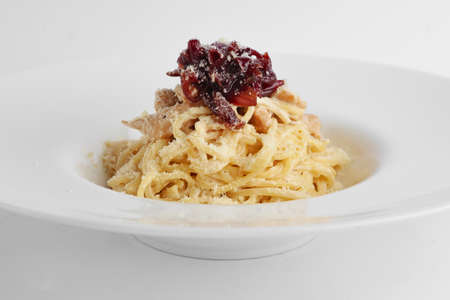 Close-up view of spaghetti with onion marmalade