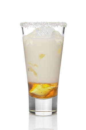 Coconut cream and rum cocktail in highball glass isolated on white. Pina colada drink.