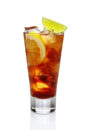 Cocktail whiskey with cola, ice, lemon and lime in highball glass isolated on white. Imagens