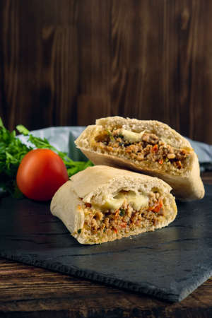 Spicy ciabatta stuffed with fried beef mince, chilli, mozzarella, tomato, bell pepper Stock fotó