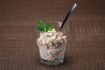 Russian traditional salad olivier with pea in glass. Reklamní fotografie
