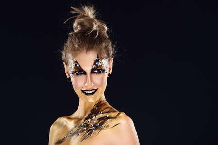 Mystic hero, golden girl. Fantasy makeup. Imagens