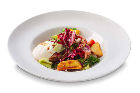 Salad with fried potato, red cabbage, mozzarella, bacon and tomato isolated on white Stock fotó