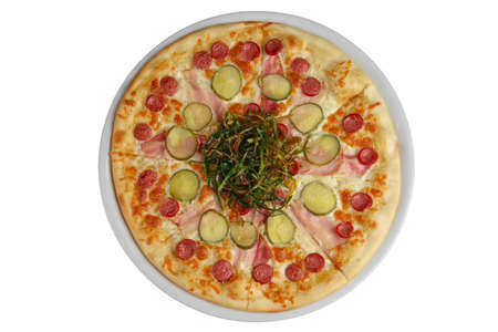Top view of pizza with sausage, ham and bacon decorated with fried green onion