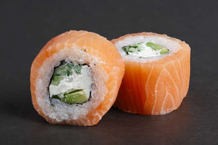 Salmon rolls with avocado and cucumber