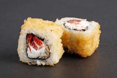 Fried rolls with pepper, eel and cheese