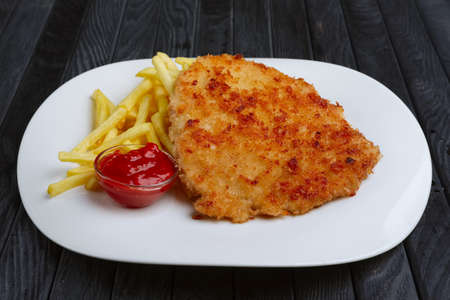 Fried chopped pork cutlet with potato balls and creamy sauce with mushroom and onion